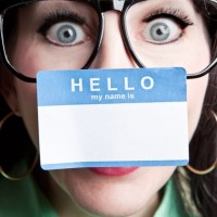 Nerdy Woman With Name Tag Stuck To Nose